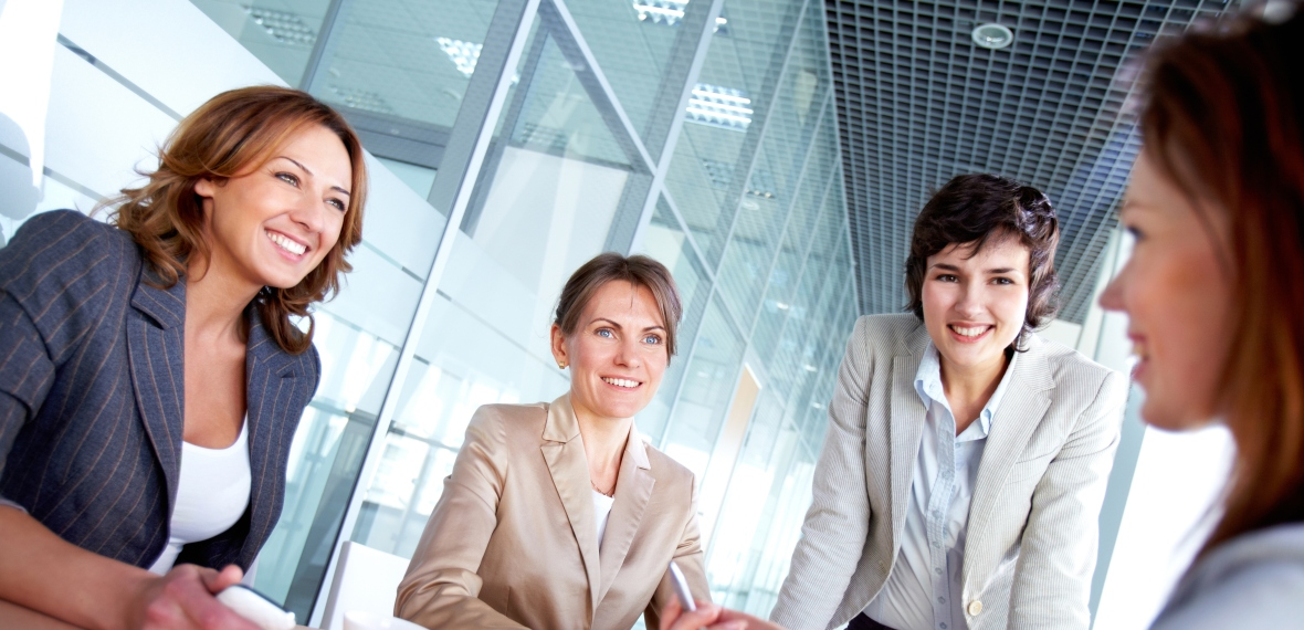 Professional women at a conference table