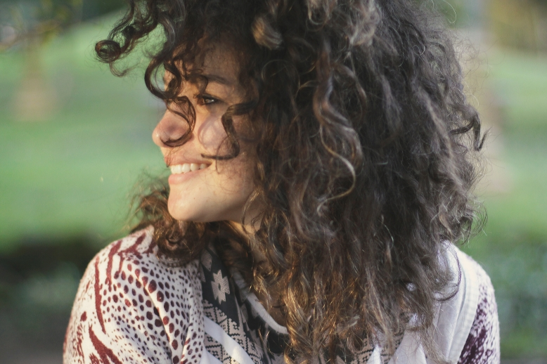 Woman smiling, looking away from the camera