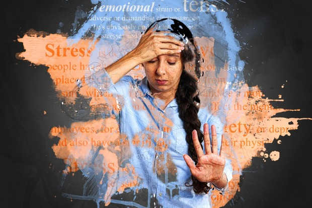 Woman holding her head and looking stressed